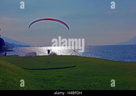 Lake Garda, paraglider - Stock Photo