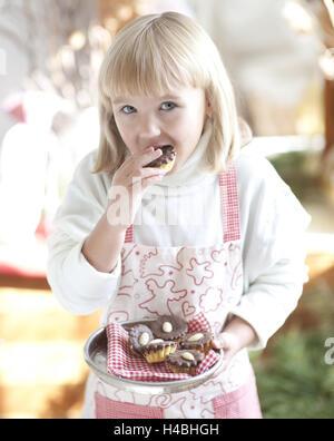 Girl, eating cookie, half portrait, - Stock Photo