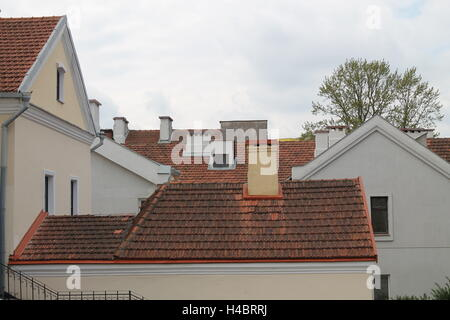 retro style covering orange tiles roofs white houses in  historical part of Minsk - Stock Photo
