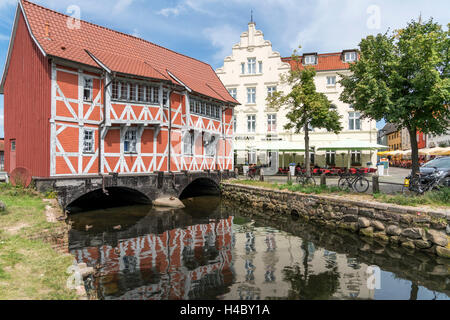 half-timbered building over the Grube river or Mühlenbach,  historic old town, Hanseatic City of Wismar, Mecklenburg - Stock Photo