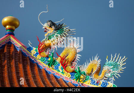 Newly painted mythological Naga dragon-headed serpent dragon at Chinese Temple, Thailand - Stock Photo