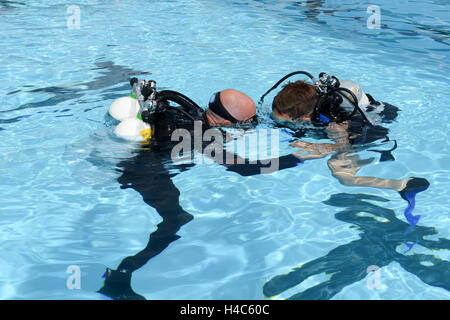 Massagno, Switzerland - 12 June 2016 -Childrens discover Scuba Diving on a swimming pool at Massagno on the italian - Stock Photo