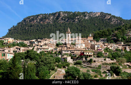 Valldemossa with parish church, in front of the mountains, island Majorca, the Balearic Islands, Spain, Europe - Stock Photo