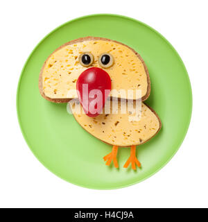 Funny chicken made of bread and cheese on plate - Stock Photo