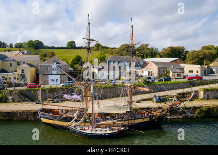 Tall ships moored in Charlestown village harbour, Cornwall, England, UK - Stock Photo