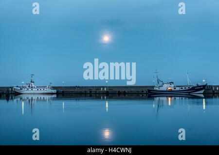 Sassnitz, Mecklenburg-West Pomerania, Germany, fishing trawler in the harbour, at night, full moon - Stock Photo
