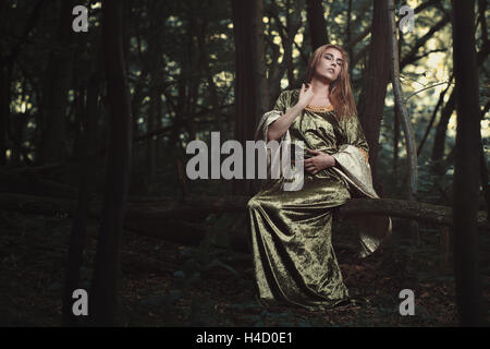 Beautiful elvish woman posing in the woods. Fantasy and fairytale - Stock Photo