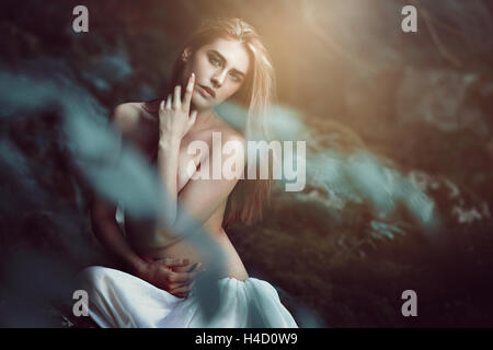 Beautiful daughter of the woods in soft dreamy light. Fantasy and magic - Stock Photo