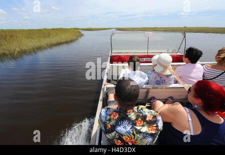 EVERGLADES, FLORIDA, USA - APRIL 30, 2016: Tourists on a boat tour through the Everglades swamp in Florida - Stock Photo