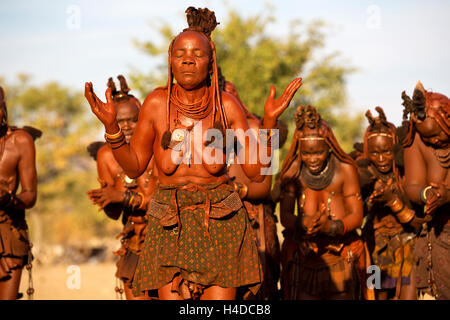 A group of unidentified Himba people perform traditional dance in their village near Opuwo town in Namibia, South - Stock Photo