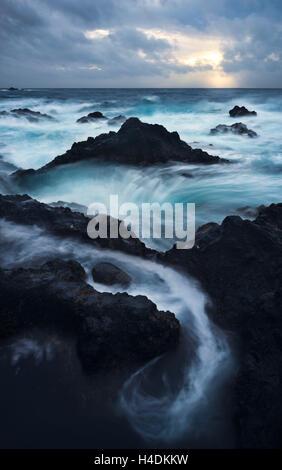 Lava coast with Ferarria, Sao Miguel, the Azores, Portugal - Stock Photo