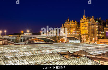 View of the city centre of Edinburgh and the roof of Waverley Railway Station - Stock Photo