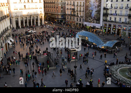Puerta del Sol, hundreds of people mill around the plaza in the late afternoon. - Stock Photo