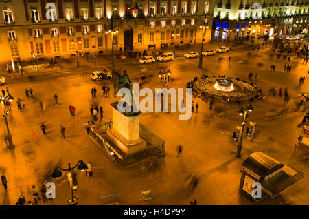 Puerta del Sol, hundreds of people mill around the plaza at night. - Stock Photo