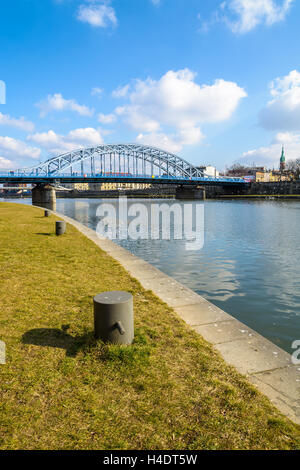 Steel bridge over Vistula river on sunny day, Krakow, Poland - Stock Photo