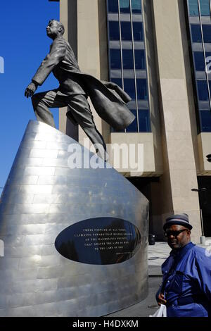 Adam Clayton Powell Jr.'s statue 'Higher Ground' in 125th Street,Harlem,New York City,USA - Stock Photo