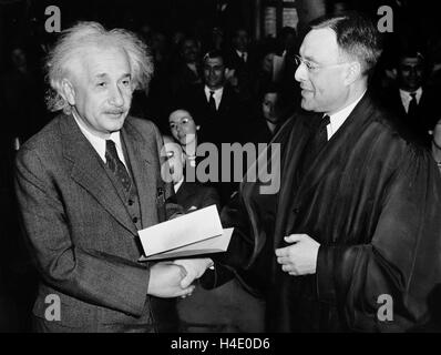 Albert Einstein (1879-1955) receiving his certificate of American citizenship from Judge Phillip Forman on October - Stock Photo