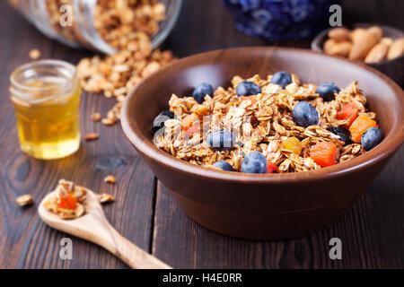 Healthy breakfast Fresh granola, muesli, berries - Stock Photo