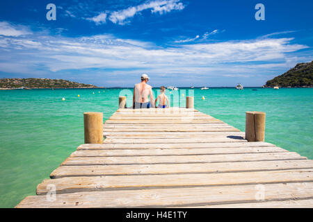 Father and his little son enjoying sea on Santa Giulia beach with tourquise clear water and pine trees, Corsica, - Stock Photo