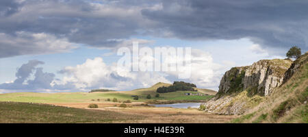 The view along Hadrian's Wall towards Steel Rigg and Crag Lough on a late summer's day in Northumberland, panorama - Stock Photo