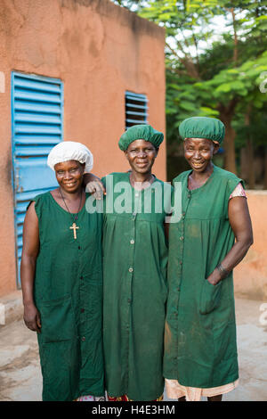 Employees stand together at a fair trade shea butter production facility in Réo, Burkina Faso, West Africa. - Stock Photo