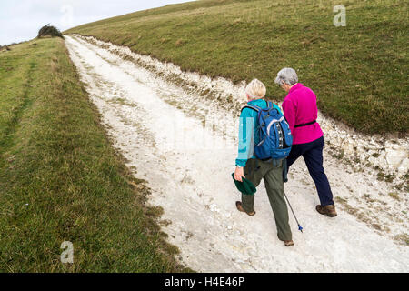 Two people walking on chalk track, Compton Down, Isle of Wight, UK - Stock Photo