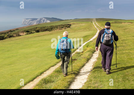 Two people walking on chalk downlands, Compton Down, Isle of Wight, UK - Stock Photo