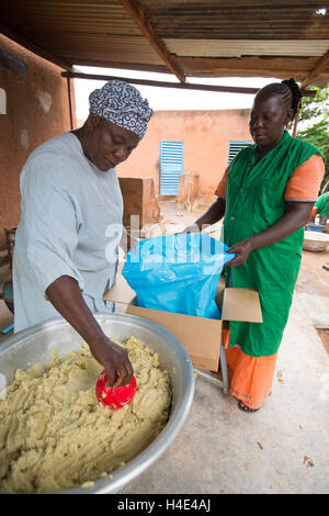 Shea butter is made at a fair trade production facilitity in Réo, Burkina Faso, West Africa. - Stock Photo