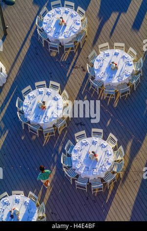 Wedding reception set up on boardwalk late afternoon at beach in Sandestin Destin Florida - Stock Photo