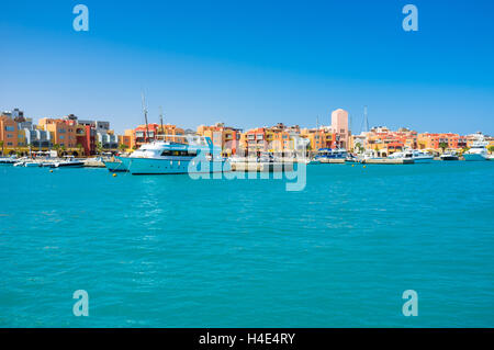 Hurghada Marina with the modern shipyard and cozy tourist quarters, Egypt. - Stock Photo