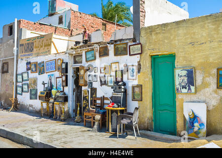 The antique store boasts many old pictures and paintings, wooden furniture and other goods - Stock Photo