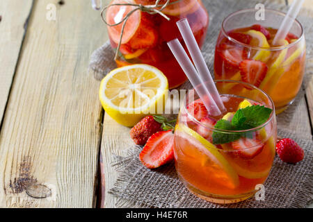 Tradition Summer mojito drink with lemon and mint with copy space in a rustic style. - Stock Photo