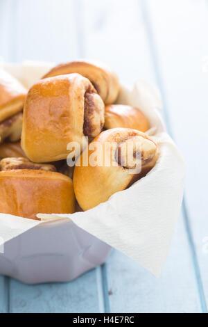Mini cinnamon buns in bowl. - Stock Photo
