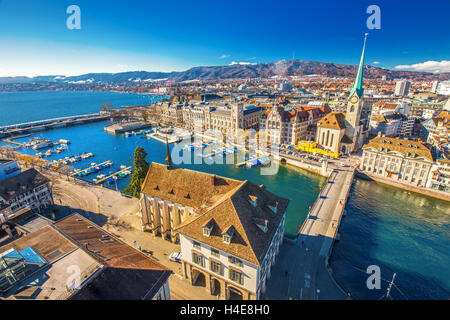 View of historic Zurich city center with famous Fraumunster Church, Limmat river and Zurich lake from Grossmunster - Stock Photo