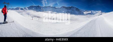 Young man ready to skiing in Swiss Alps mountain ski resort, Elm, Switzerland - Stock Photo