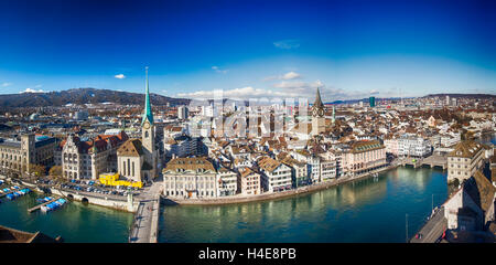 View of historic Zurich city center with famous Grossmunster Church and Limmat river, Switzerland - Stock Photo