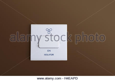 Extractor fan isolator switch mounted on interior wall, copy space - Stock Photo