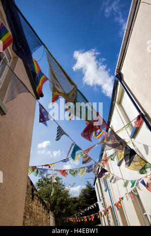 Bunting flags decoration hang between houses in One End Street  Appledore near Bideford North Devon England UK - Stock Photo