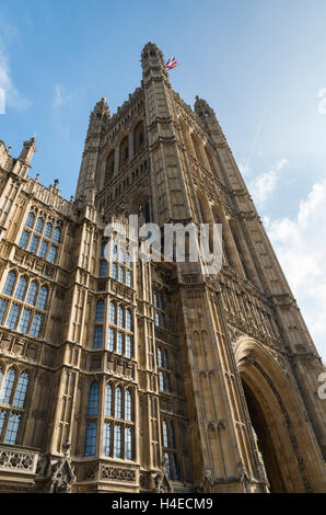 Looking upwards at the architecture of the Victoria Tower at the Palace of Westminster / Houses of Parliament in - Stock Photo