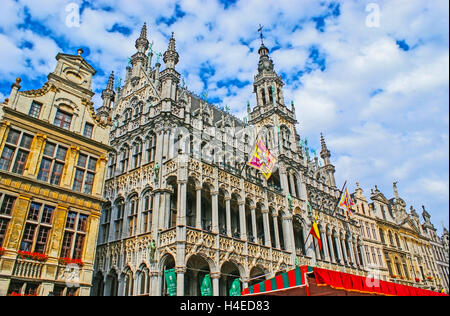 The King's House on the Grand Place decorated with old religious flags before the Ommegang celebration - Stock Photo