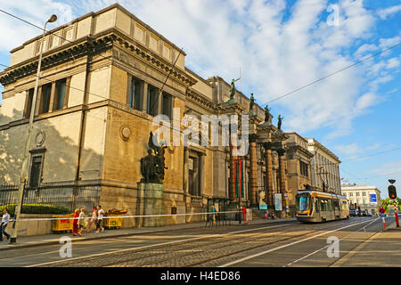 The Royal Museum of Fine Arts with its stone columns and scenic sculptures makes the contrast with the modern tram - Stock Photo