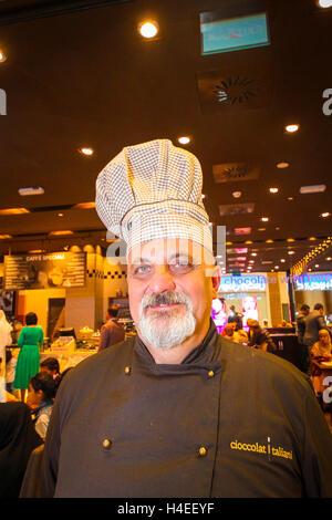 Italian chocolate chef look at camera in luxury chocolate shop in Kuwait - Stock Photo