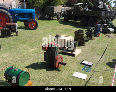Line up of vintage stationary engines and vintage vehicles on display at Baston in the blitz weekend - Stock Photo
