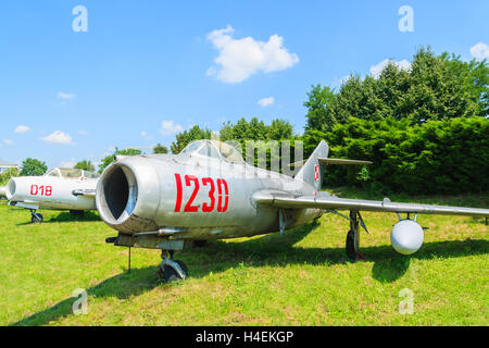 KRAKOW MUSEUM OF AVIATION, POLAND - JUL 27, 2014:  military fighter MIG-21  aircraft on exhibition in outdoor museum - Stock Photo