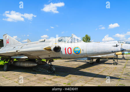 KRAKOW MUSEUM OF AVIATION, POLAND - JUL 27, 2014: military fighter aircraft on exhibition in outdoor museum of aviation - Stock Photo