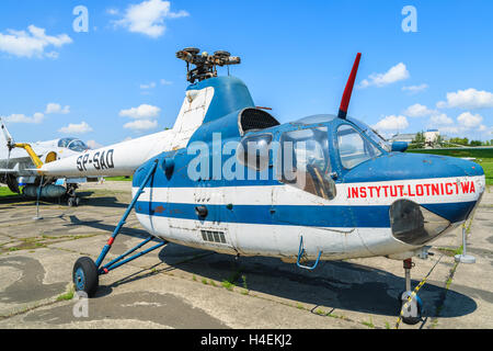 KRAKOW MUSEUM OF AVIATION, POLAND - JUL 27, 2014: small helicopter on exhibition in outdoor museum of aviation history - Stock Photo