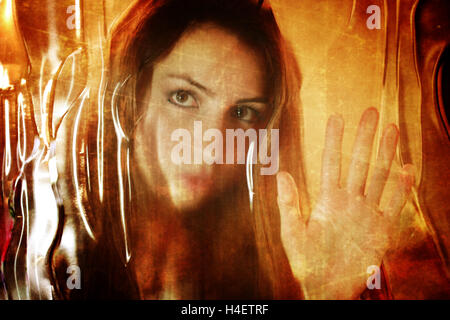 scratched effect on photo girl face behind dirty glass - Stock Photo