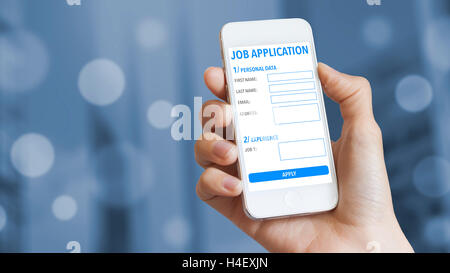 Online job application on mobile phone with business district in background - Stock Photo