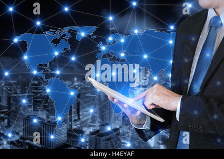 Double exposure of businessman using digital tablet connecting global business. Technology and network connection - Stock Photo