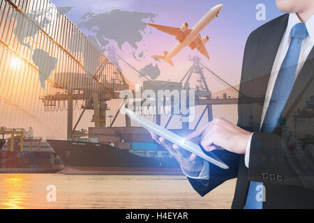 Businessman press digital tablet to show global network partnership connection use for logistics background. - Stock Photo